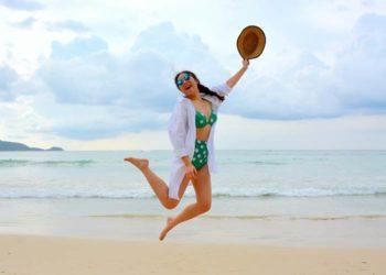 girl-jump-beach